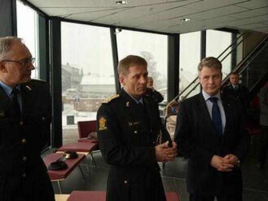 Politimester Johan Brekke (i midten)
